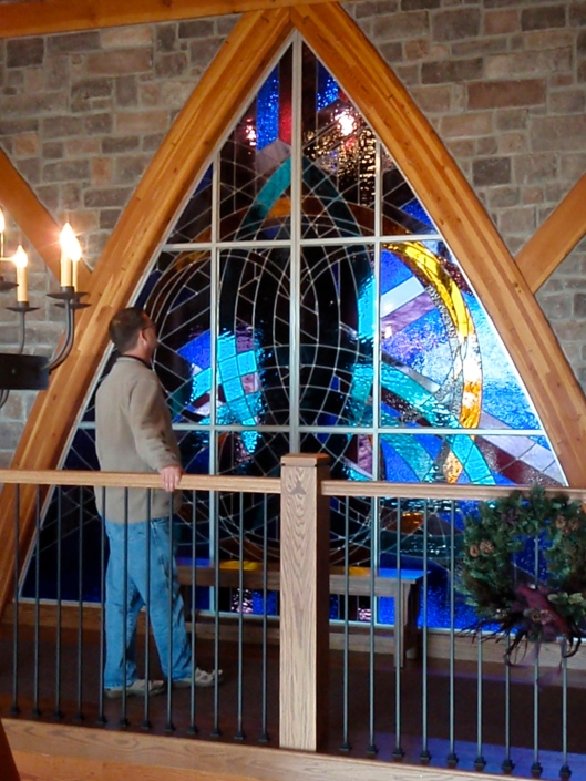 FAS stained glass window installed, shows scale, completion, and detailed woodwork.
